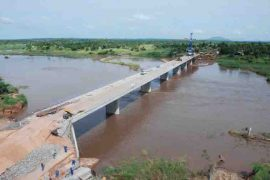 "<div style=""text-align:center; color:white;""><div style=""font-size:17px; "">Bridge over the Lugela River (Mozambique)</div><br>Client: Administração Nacional de Estradas<br>Year: 2006 – 2007</div>"