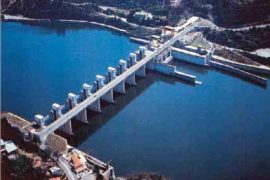 """<div style=""""text-align:center; color:white;""""><div style=""""font-size:17px; """">Crestuma / Lever Hydroelectric Power Station</div><br>Client: EDP<br>Year: 1978 – 1984</div>"""