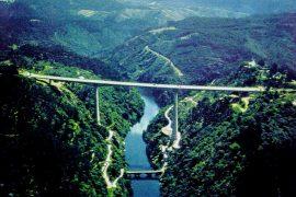 """<div style=""""text-align:center; color:white;""""><div style=""""font-size:17px; """">Bridge over the Zêzere River on the IC8</div><br>Client: Junta Autónoma de Estradas<br>Year: 1993 – 1995</div>"""