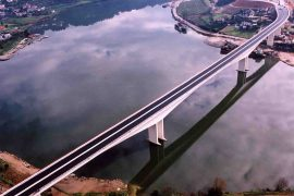 """<div style=""""text-align:center; color:white;""""><div style=""""font-size:17px; """">Bridge over the Douro River in Entre-os-Rios</div><br>Client: ICOR<br>Year: 2001 – 2003</div>"""