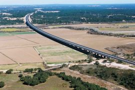 """<div style=""""text-align:center; color:white;""""><div style=""""font-size:17px; """">Viaduct over the Sorraia River on the A13</div><br>Client:  Brisa SA<br>Year: 2003 – 2005</div>"""