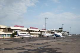 """<div style=""""text-align:center; color:white;""""><div style=""""font-size:17px; """">Maputo Airport (Mozambique)</div><br>Client: Dir. Geral de Aeronáutica Civil<br>Year: 1952 – 1962</div>"""