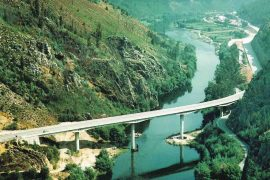 """<div style=""""text-align:center; color:white;""""><div style=""""font-size:17px; """">Bridge over the Mondego River</div><br>Client: JAE – Junta Autónoma de Estradas <br>Year: 1991 – 1992</div>"""